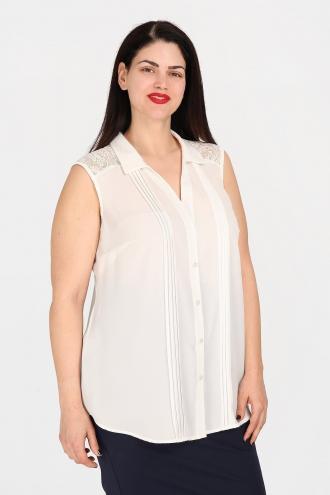 4bd7f9ae81f0 Αμάνικο πουκάμισο σε ίσια και άνετη γραμμή. Με γιακά και πατιλέτα με  κουμπιά. Διακοσμημένο