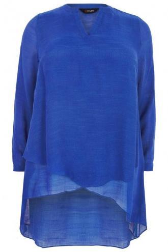 3c1cf6d7913f Ασύμμετρη μπλούζα σε μπλε χρώμα με ελαφριά μεταλλική όψη. Ιδανική για να  φοριέται από το