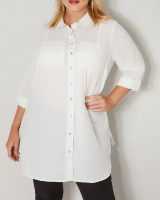 02a34b3449f7 Μακρύ πουκάμισο σε ιβουάρ χρώμα με τσέπες στο στήθος και κουμπί στο μανίκι  για να μαζεύει